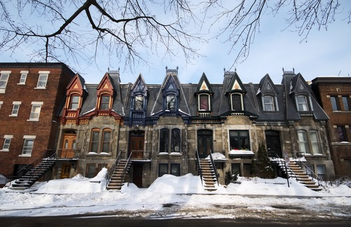A row of Victorian-era homes in Montreal, each with its own outdoor staircase