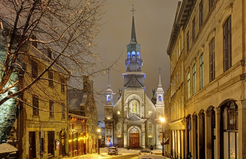 A church on a snowy street in Montreal