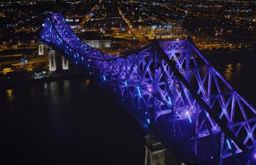 Montreal's Jacques Cartier bridge is turned purple during its hourly evening Living Connections light show.