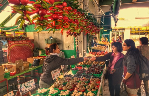 Shoppers at a produce stand at the Marché Jean-Talon in Montreal.