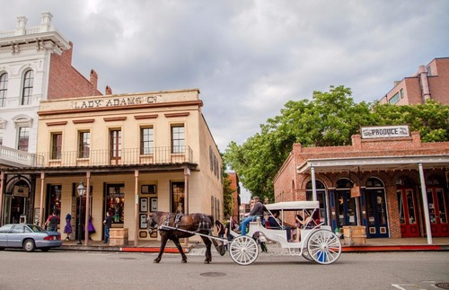 Visitors to Old Sacramento enjoy the view from a horse-drawn carriage