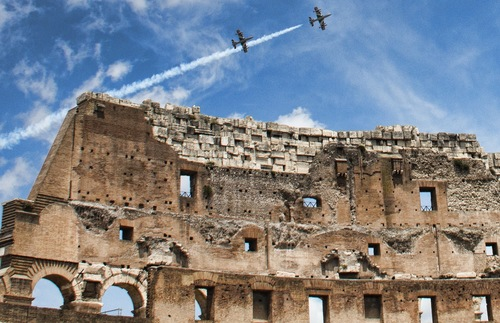 Two planes fly over Rome's Colosseum