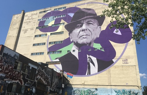 A massive mural of Leonard Cohen is at the heart of the mural district of Montreal