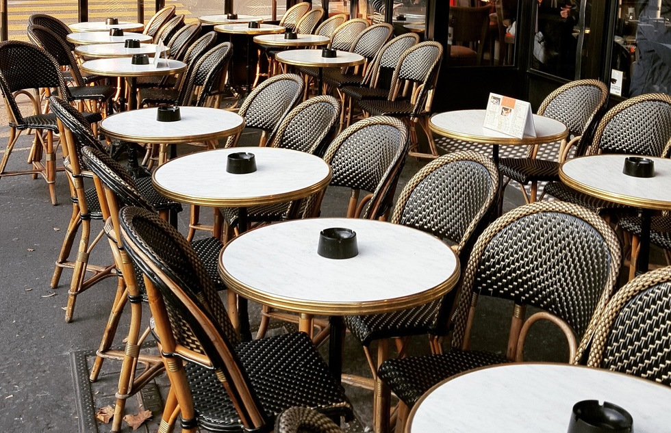 Sidewalk cafe tables in Paris