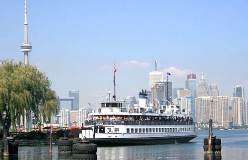 A ferry takes passengers between Toronto's Harbourfront area and the Toronto Islands
