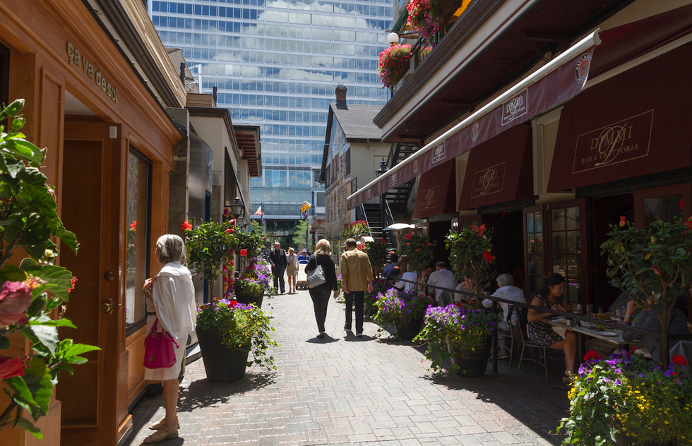 A laneway lined with restaurants and shops in Toronto's tony Yorkville area