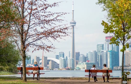 A view of the Toronto skyline from park benches on the Toronto Islands