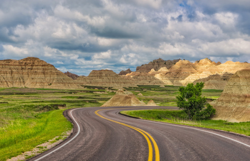Drive Loop Road and hike Notch Trail in Badlands National Park for striking views of naturally eroded land and vast priaries.