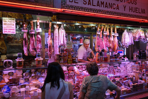 Shop like a local at Mercado Anton Martin and try some traditional food.