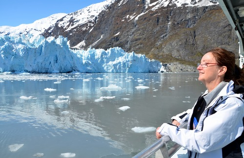 A woman on a glacier watching cruise.