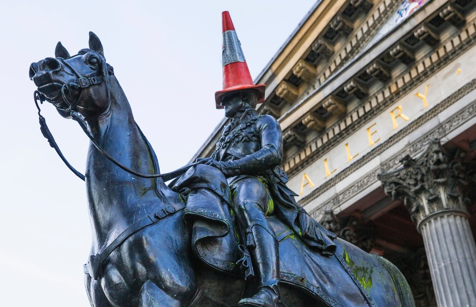 Cone-topped equestrian statue of the Duke of Wellington in front of the Gallery of Modern Art in Glasgow