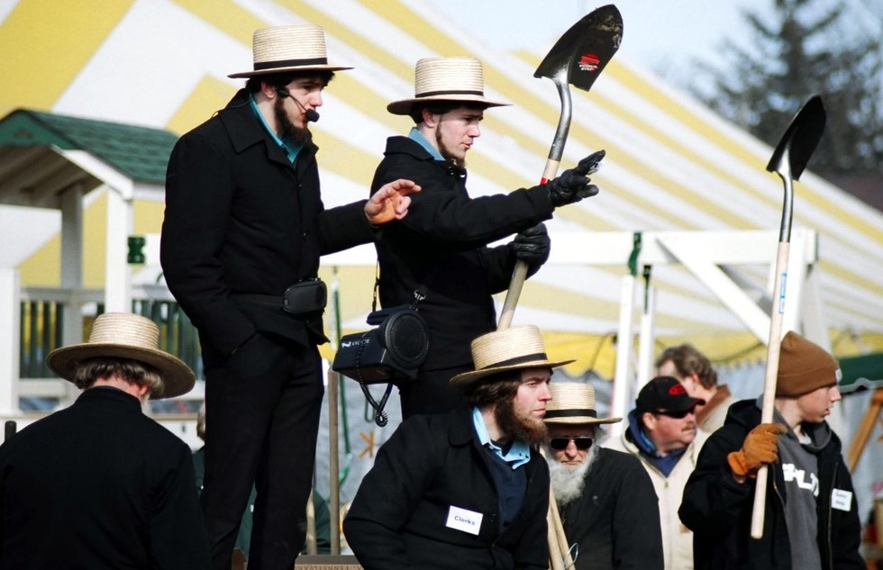 Amish auctioneers at a mud sale in Lancaster County, Pennsylvania