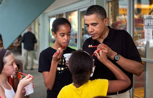 Barack Obama and daughters Malia and Sasha at Island Snow in December 2010