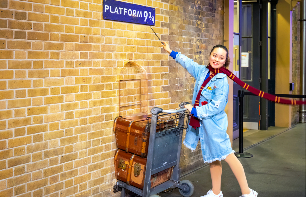 Harry Potter fans can visit Platform 9 3/4 at the Kings Cross Railway Station in London, England.
