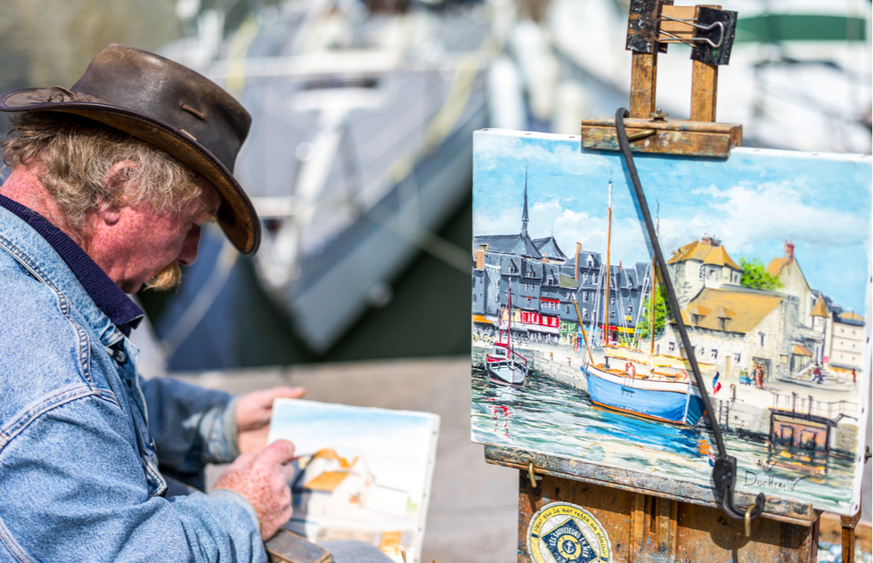 A painter in Honfleur, France