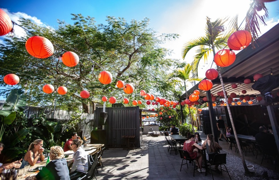 Outdoor seating at 1-800-Lucky food hall in Miami