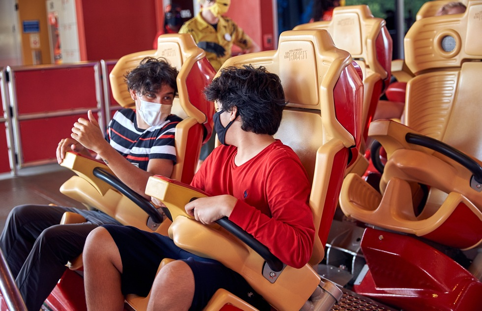 Masked roller coaster riders at Universal Orlando Resort in Florida
