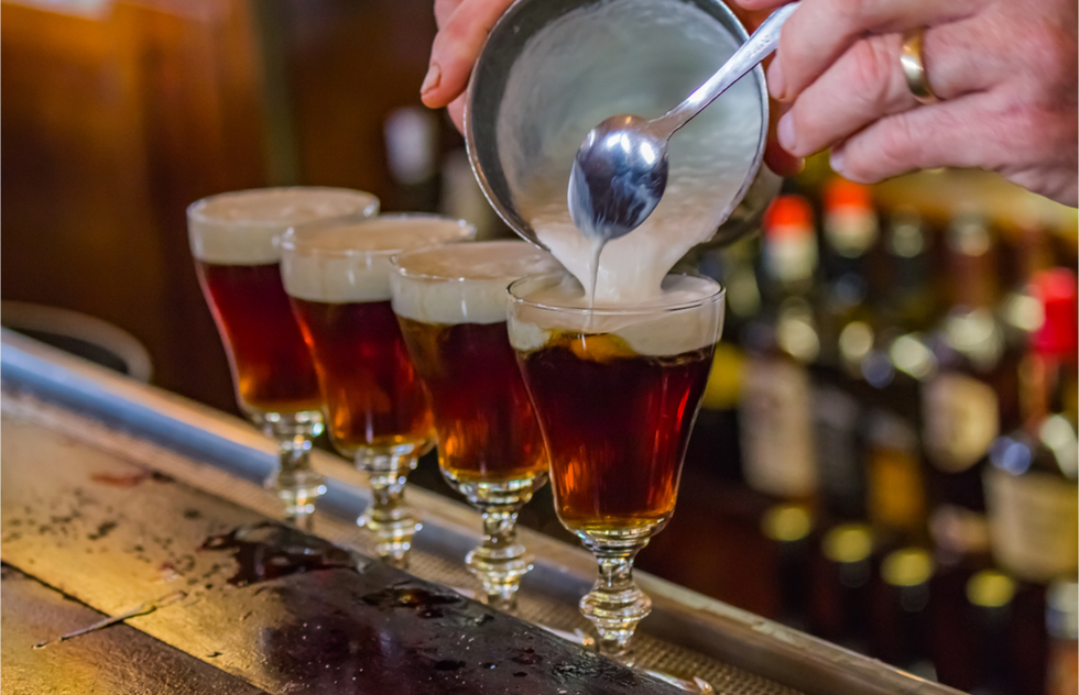 A bartender tops Irish Coffee with cream at the Buena Vista Cafe in San Francisco