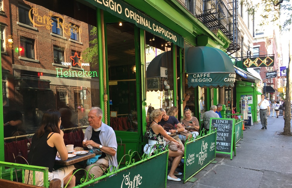 A photo of diners enjoying an afternoon visit to Caffe Reggio in New York City