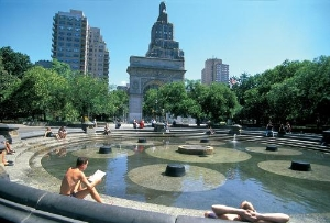 People sitting around a water feature in Washington Square Park, Greenwich Village.