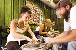 Sundance instructor assists a guest in creating their first piece of pottery. Photo: Adam Brown/Sundance Resorts