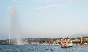 A boat passes by the Jet d'Eau, Lake Geneva, Geneva, Switzerland.