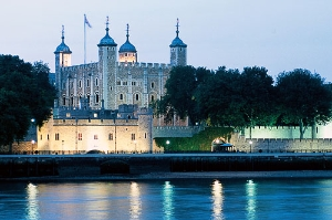 Evening view of the Tower of London, seen from across the River Thames.