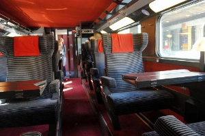 "First-class train seats in a ""quiet car"" aboard a TGV train to Paris."