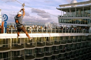 A zipline lets passengers fly nine stories about the Boardwalk neighborhood, starboard to port.