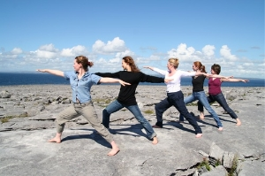 Yoga poses on the limestone rocks overlooking the Atlantic Ocean, at Burren Yoga and Meditation Centre
