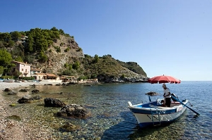 The pace of life is a little slower in Italy's deep south; here, the coast near Taormina, Sicily.