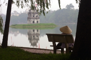 Woman relaxing on the banks of Hoan Kiem Lake, Hanoi