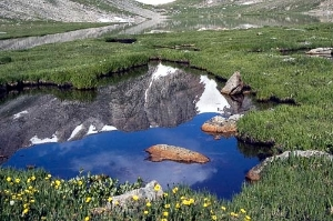A reflection as seen in a valley basin atop Mount Evans in the Colorado Rockies. Courtesy Colorado Tourism