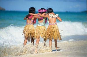 Three girls on a beach in Hawaii