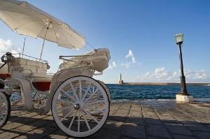 White carriage waiting for passengers in the old harbor of Chania, Crete