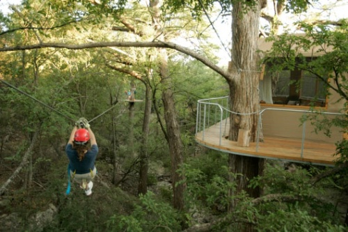 A guest zips past the Lofthaven at Cypress Valley Canopy Tours outside Austin, Texas. Photo by Erich Schlegel / Cypress Valley Canopy Tours