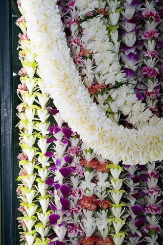 You'll find leis of every color and description for sale in Chinatown.