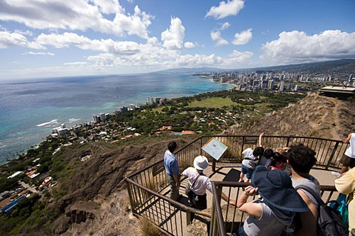 You have to pay a $1 fee to climb the 1.4 miles to the top of Diamond Head, but the view from the 750-foot summit is priceless.