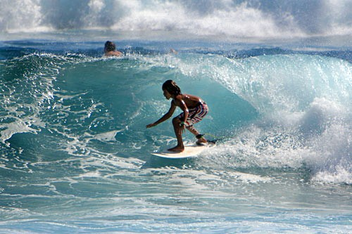 Poipu Beach is a great place for novice surfers.