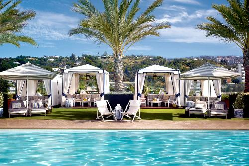 Cabanas and grass surround the rooftop pool at the London West Hollywood.