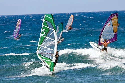 Windsurfers love the powerful winter breezes and smooth surf at Hookipa Beach.