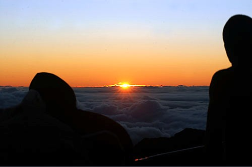 Watching the sun rise atop Haleakala.