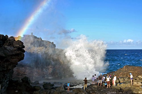 Hikers stopped alongside the Nakalele Blowhole Trail in Maui.