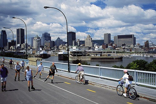 The explosion of cycling in Montréal—thanks to programs such as BIXI—has forced the city to take steps to accommodate its two-wheeled travelers. The city boasts more than 450km (280 miles) of bike lanes. Dedicated paths on major throughways such as Rue Rachel and Boulevard de Maisonneuve allow cyclists to move more safely alongside cars, and curb bulges are gradually being constructed at intersections to force cars to slow down and make room for bikes. Organizations like the nonprofit Vélo Québec are working to improve the safety of existing lanes and to create new ones.