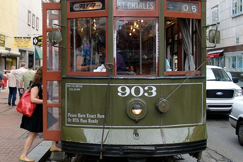 A classic St. Charles streetcar, picking up at Canal Street in New Orleans.