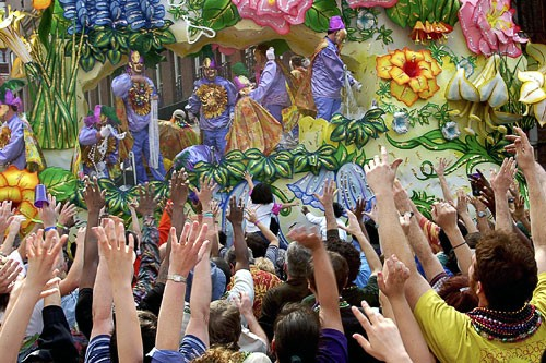 Mardi Gras float and crowd in New Orleans.