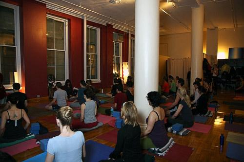 Elena Brower leads a crowded class at Virayoga, hidden from the noise and traffic on Broadway. Courtesy Virayoga