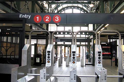 Entering the turnstiles in a New York City subway station.