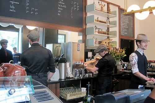 Stumptown Coffee, which adjoins the lobby of New York City's Ace Hotel, has baristas clad in dapper uniforms and caps.