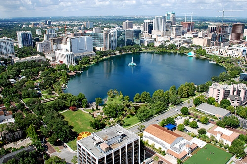 Lake Eola Park is a popular destination in the downtown Orlando area, with many people taking advantage of the beautiful surroundings.